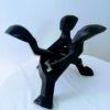 Sculpture en bois (3hommes se tenant la main)
